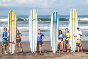 Group of surf students in Jacó Beach
