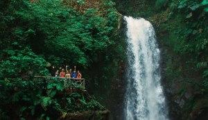 Travelers in Costa Rica enjoying the beautiful waterfalls