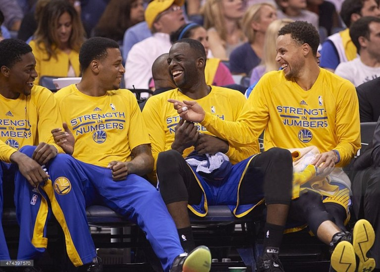 Basketball: NBA Playoffs: Golden State Warriors (L-R) Justin Holiday, Brandon Rush, Draymond Green and Stephen Curry laughing on bench during game vs Memphis Grizzlies at FedEx Forum. Game 6. Memphis, TN 5/15/2015 CREDIT: Greg Nelson (Photo by Greg Nelson /Sports Illustrated/Getty Images) (Set Number: X159589 TK1 )