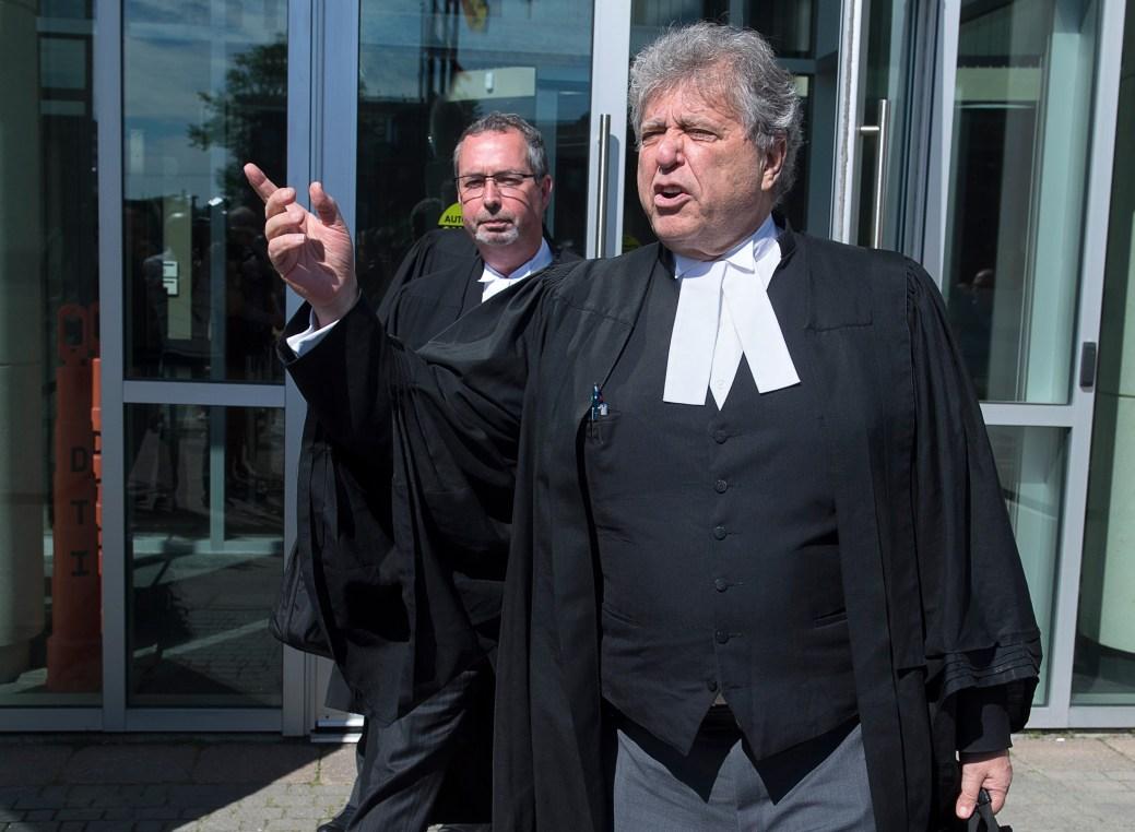 Alan Gold et Michael Lacy, les avocats de la défense, à la sortie du palais de justice. - PC