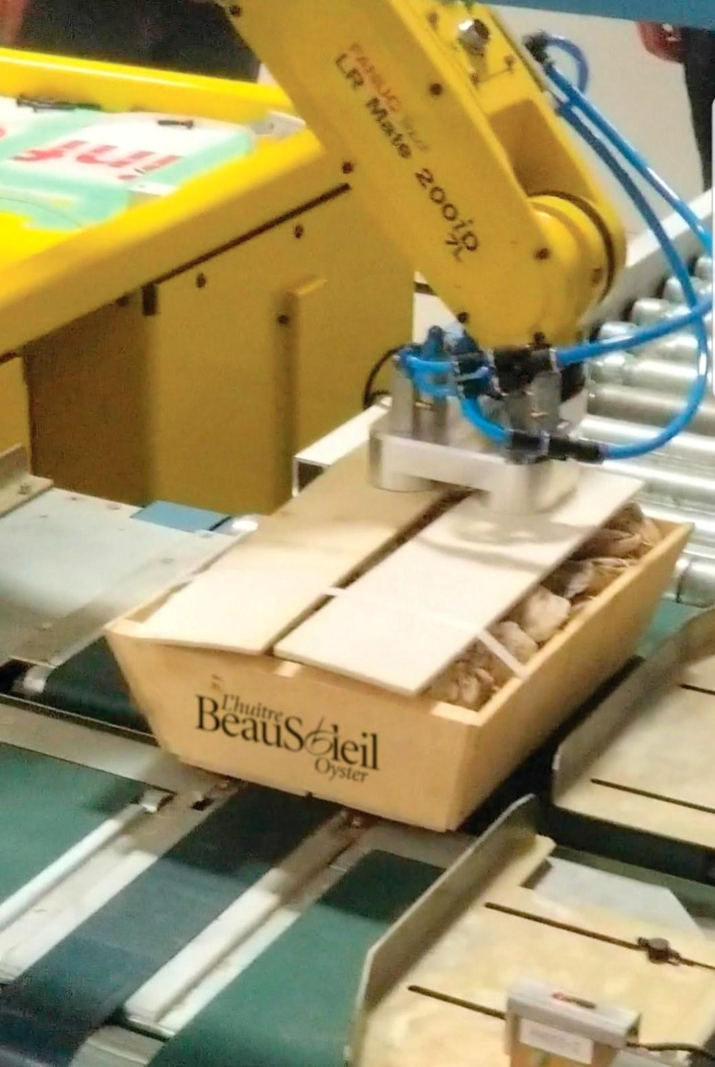 L'un des robots (ici en phase prototype) s'occupera de refermer les boîtes. - Gracieuseté