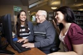 Volunteers Teach Seniors How to Use a Computer