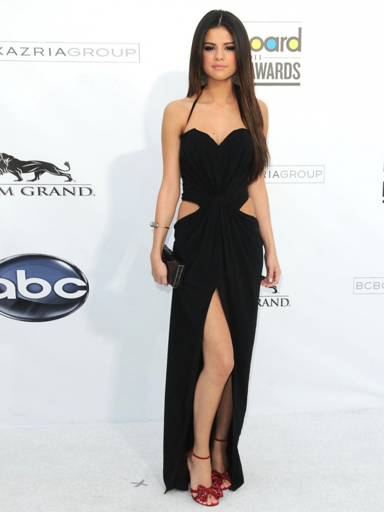 Selena Gomez is at the Billboard Music Awards wearing a black Dolce and Gabbana cutout dress, May 2011