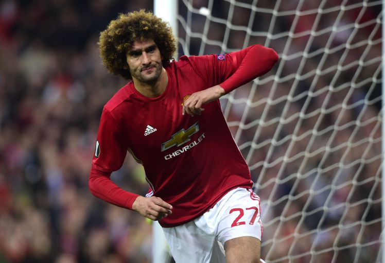 Manchester United's Belgian midfielder Marouane Fellaini celebrates after scoring the opening goal of the UEFA Europa League semi-final, second-leg football match between Manchester United and Celta Vigo at Old Trafford stadium in Manchester, north-west England, on May 11, 2017. / AFP PHOTO / Miguel RIOPA        (Photo credit should read MIGUEL RIOPA/AFP/Getty Images)