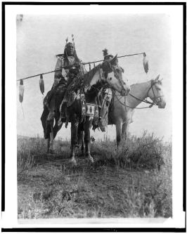 Village criers on horseback, Crow Indians