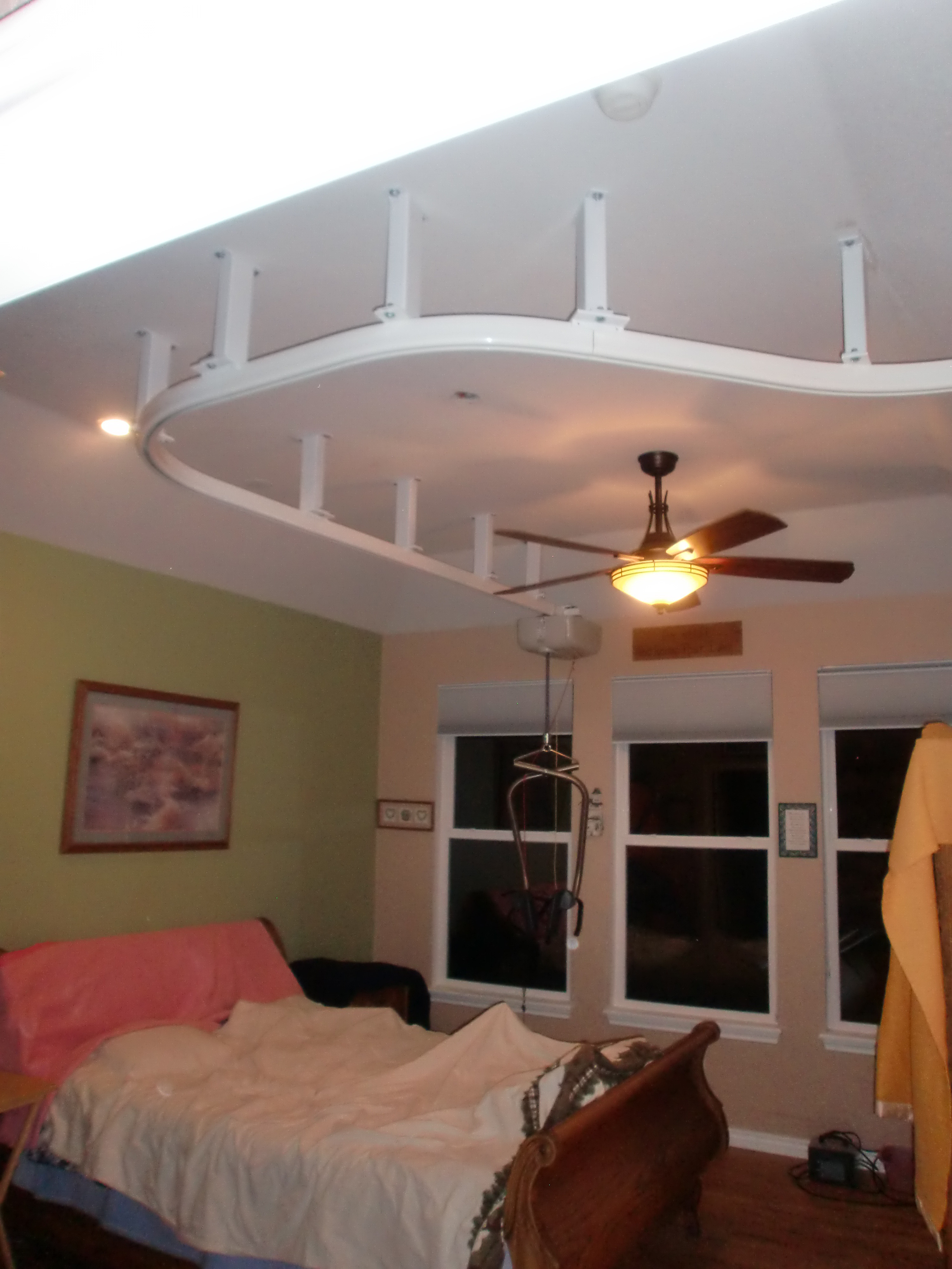 Suspended Ceiling Lift goes from bedroom to bathroom in