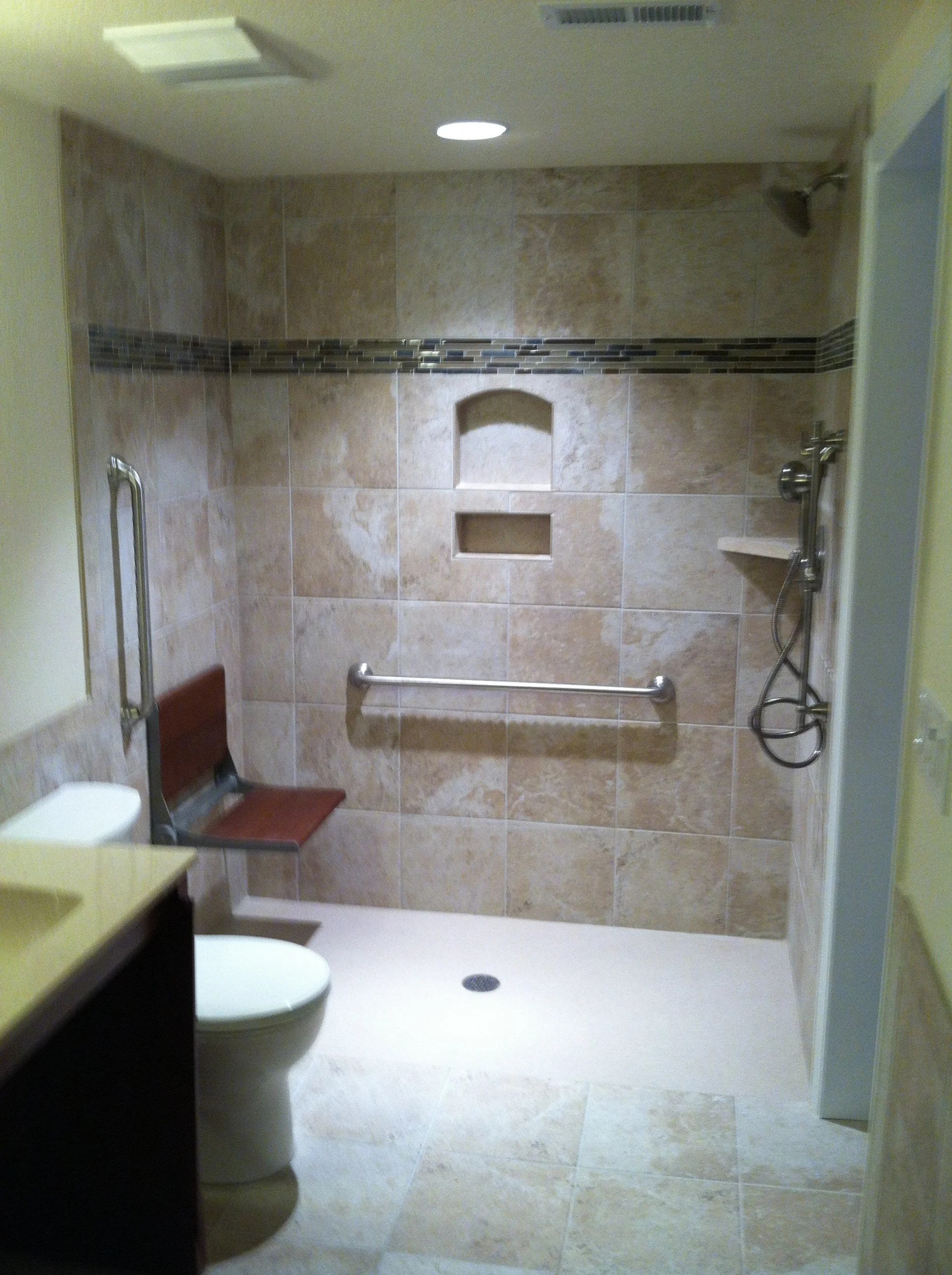 wheelchair elevator black and white wing chair euro style shower with folding bath bench arvada, co - accessible systems