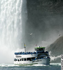 A Maid of the Mist ship exits the base of Horseshoe Falls