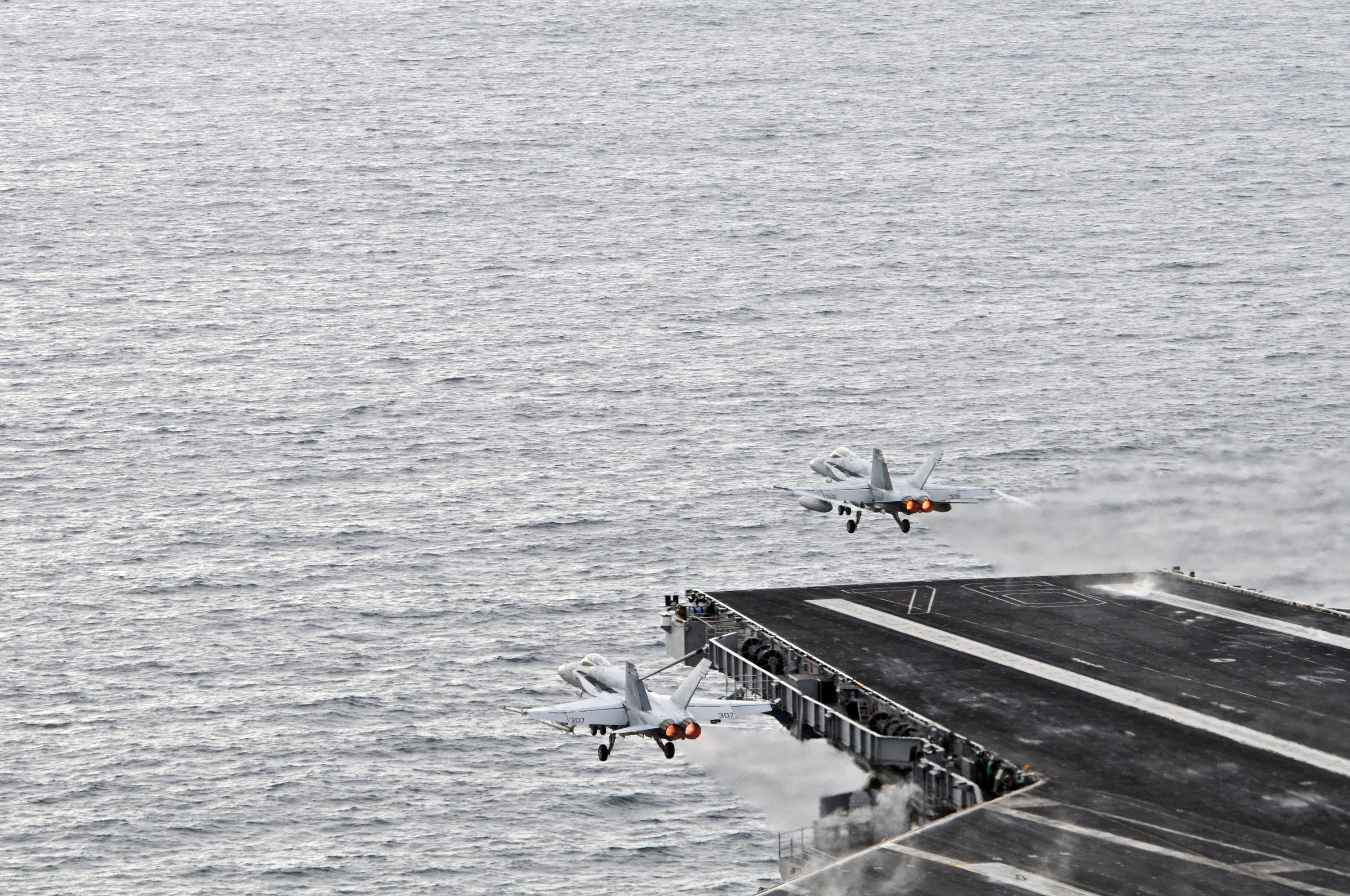Jets Taking Off From The Flight Deck Of An Aircraft