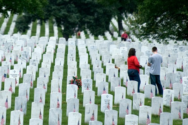 Stock Of People Visiting Military Gravesite