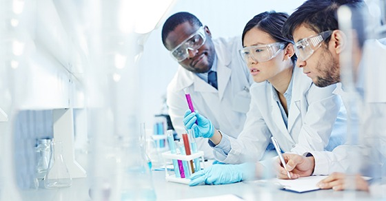 three scientists working in the lab
