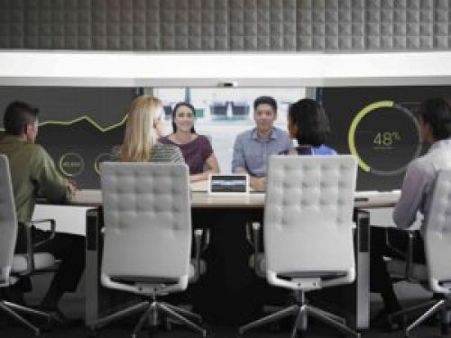 business professionals holding a video conference call using Cisco TelePresence
