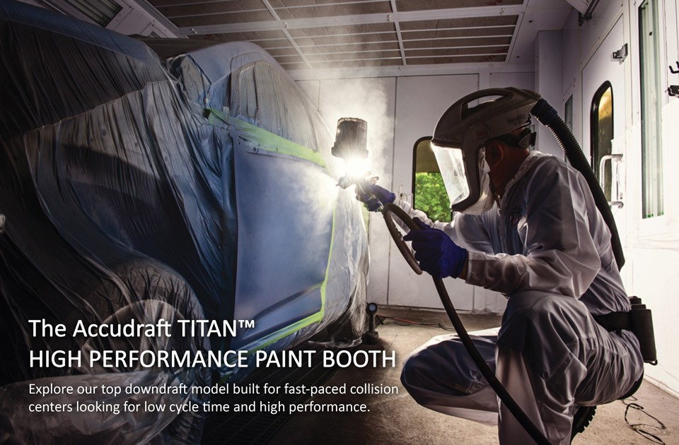 Painter-Using-Accudraft-TITAN-Downdraft-Paint-Booth-with-TITAN-Text