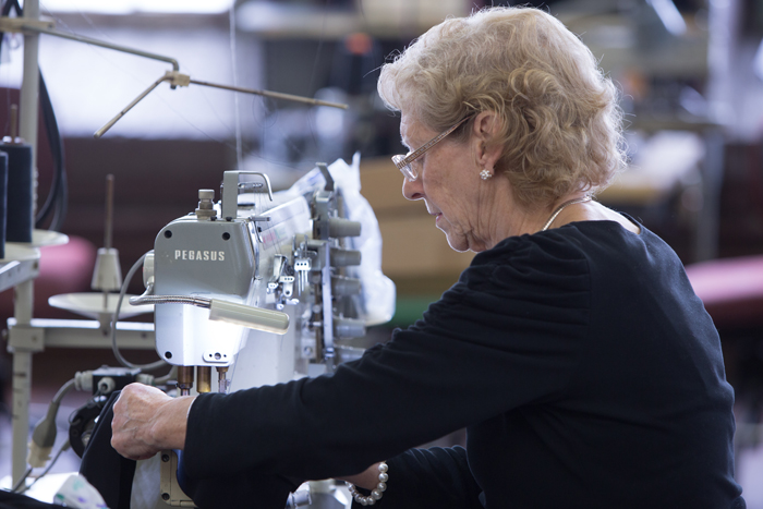 A stitcher sewing samples in Accurate's factory