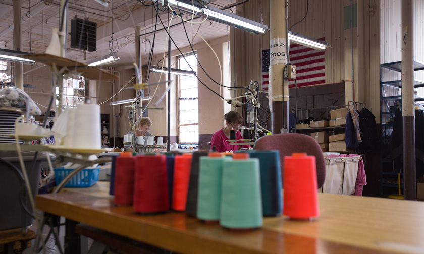 Sewing floor with thread cones and American Flag