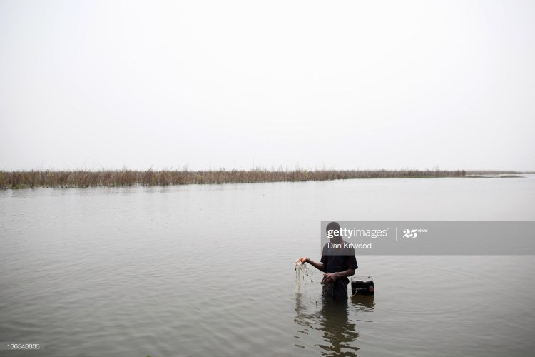 GANVIE, BENIN - JANUARY 06:  A boy fishes with a net in the lagoon on January 6, 2012 in Ganvie, near Cotonou, Benin. Often called the Venice of Africa, Ganvie is a stilted fishing village on Lake Nokoue, near Cotonou in Benin, the largest such village in Africa, and home to approximately 20,000 residents.  (Photo by Dan Kitwood/Getty Images)