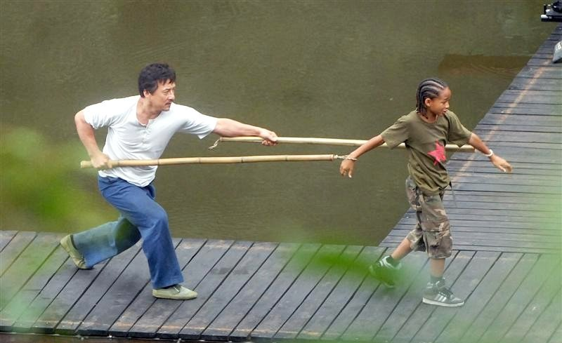 A stached Jackie Chan tortures Jaden Smith