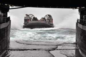 US Navy LCAC coming aboard Navy ship at sea