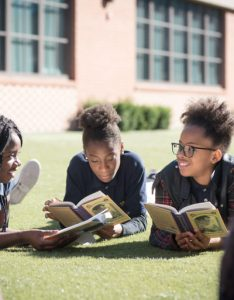 Current amistad academy middle students enjoying  day of reading on the lawn also what makes charter schools special achievement first rh achievementfirst