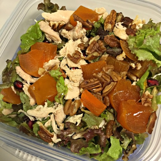Salad with chicken, persimmons, and pomegranate