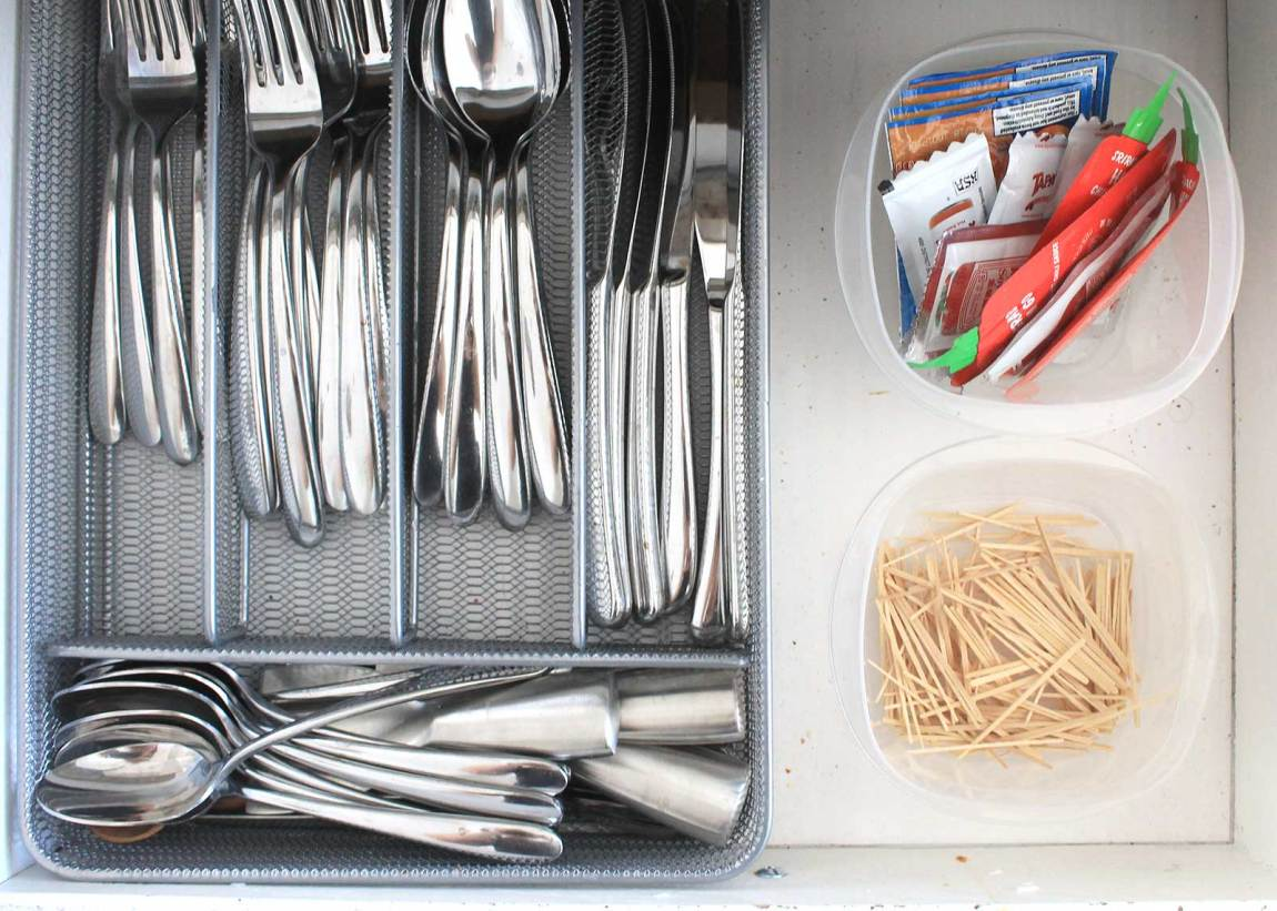 Repurpose plastic containers to store junk drawer items