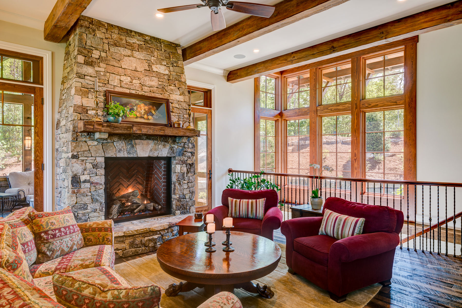 Stone Fireplace Den With Open Staircase To Basement Acm Design Architecture Interiors