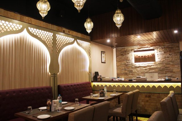 Warm soothing interiors with arches and jaali features signifying the mughal architecture.