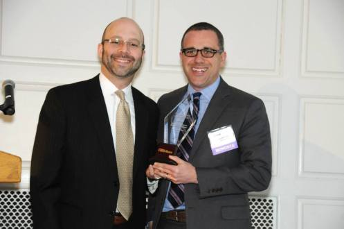 Connecticut Personal Injury Attorney Ryan McKeen getting an award from the CT Personal Injury Hall of Fame.
