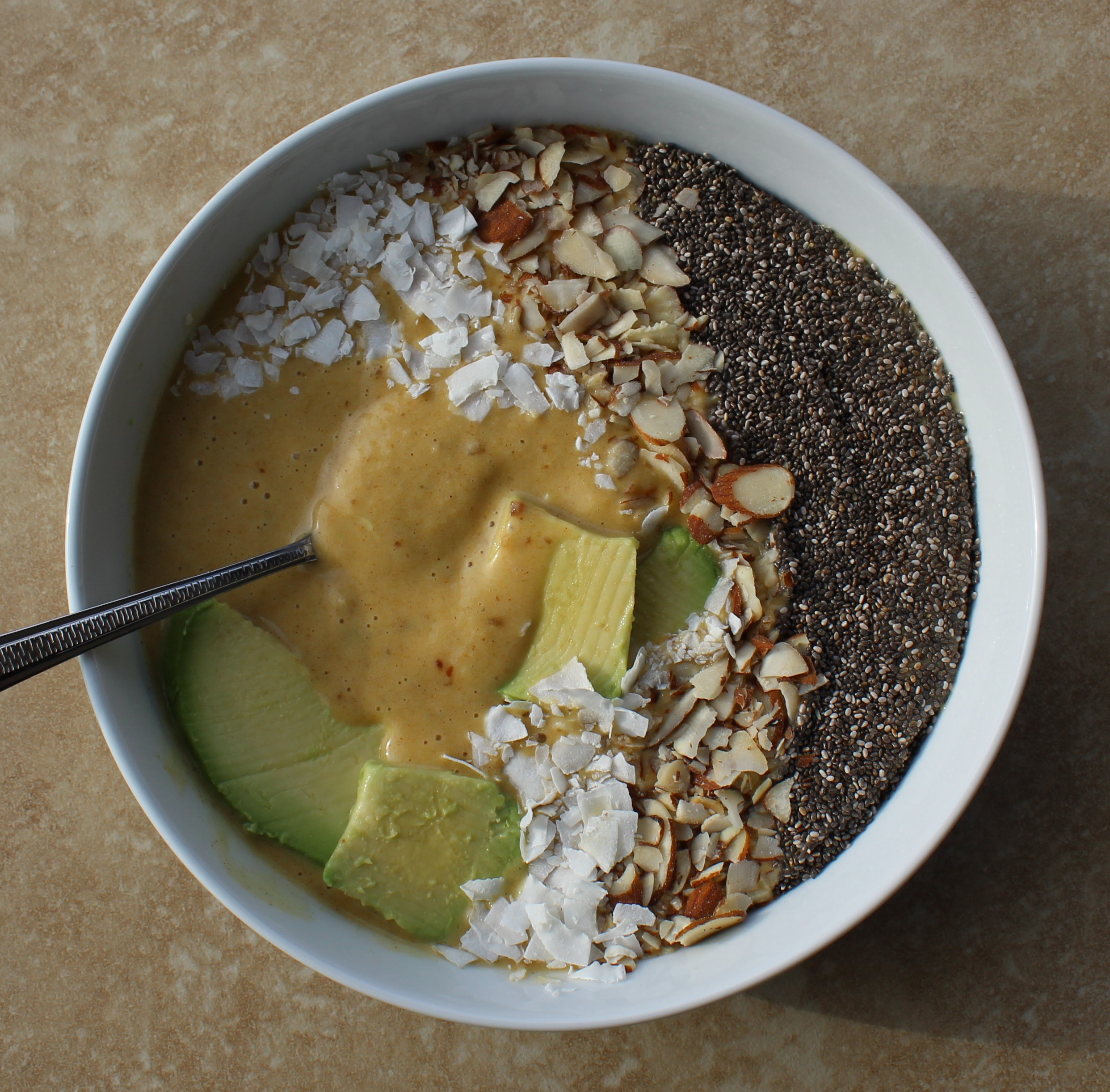 Turmeric-Kissed Date and Banana Smoothie Bowl with Sliced Avocado 2