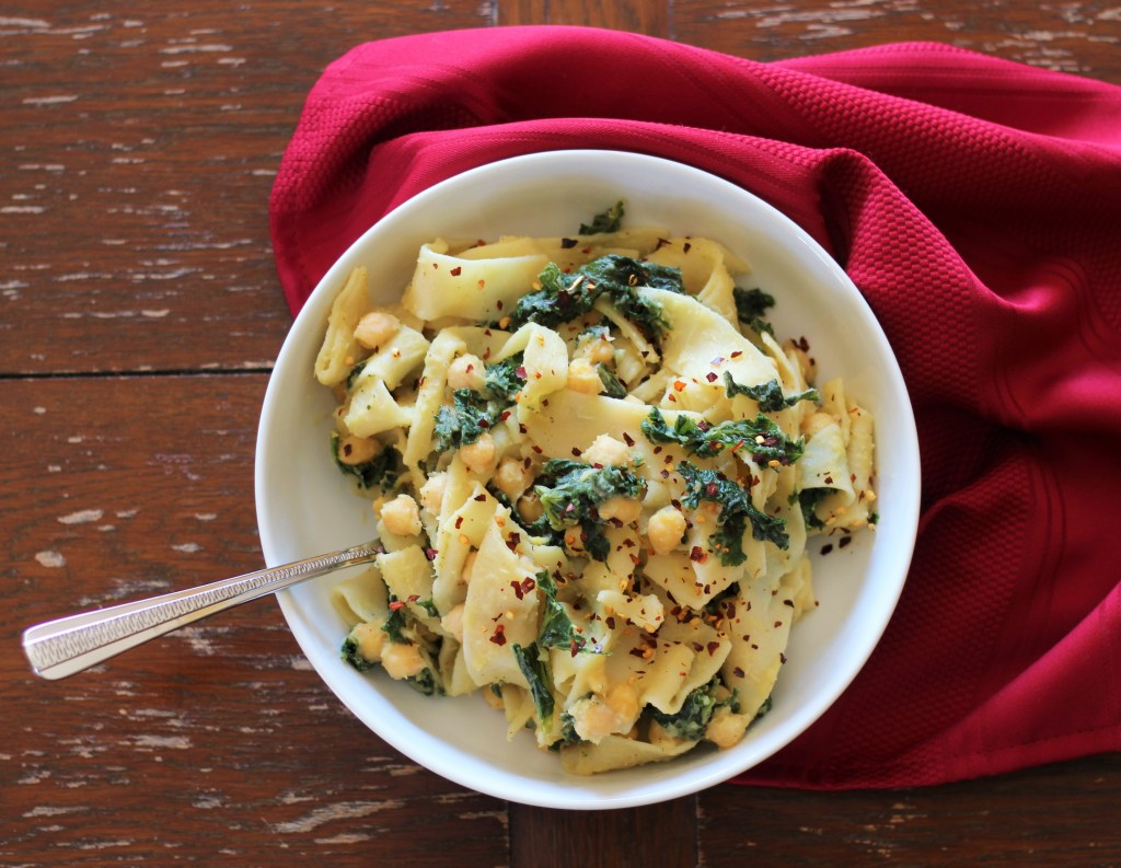 A bowl of Chickpea, Kale, and Acorn Squash Pappardelle Pasta