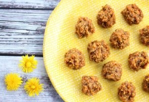 A close-up of Carrot Cake Energy Balls on a yellow plate