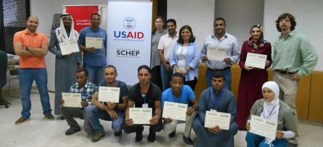 The participants and organizers of the first SCHEP site steward workshop. Back row, left to right: Ragheb Fityan (SCHEP M&E Specialist), Mohammad al-Saideen (Bi'r Mathkour), Bilal al-Deghemat (Ghor al-Safi), Erin Addison (SCHEP CHR Projects Lead), Abdelrahman al-Nasarat (CHR Projects Lead Assistant), Huda Kilani (SCHEP Capacity Building Lead), Muaffaq al-Masaeed (Umm al-Jimal), Safa' al-Rfooh (Busayra), Glenn J. Corbett (ACOR Associate Director); front row (kneeling, left to right): Abdulah al-Saideen (Bi'r Mathkour), Ahmad Mowasa (Petra), Ali al-Soide (Busayra), Nayef Shamalat (Ghor al-Safi), Abdelrahman al-Masaeed (Umm al-Jimal), Eman Abdalsalam (Petra). Photo by Wiebke Lepke.