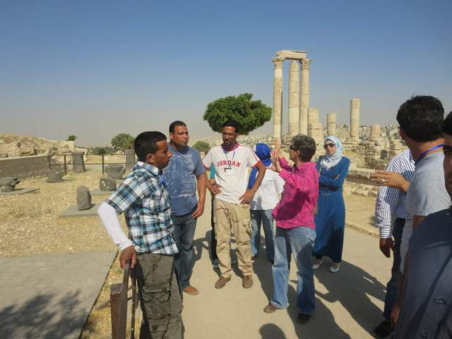 Shan Tsai (center, in pink shirt), former DOA site manager for Jabal Qala', leads the SCHEP site stewards on a tour of the Amman Citadel ruins. Photo by Abdelrahman al-Nasarat.