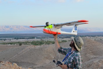 Chad Hill preparing to launch a fixed wing drone at Feifa, Jordan 2014 (Photo by Morag Kersel)