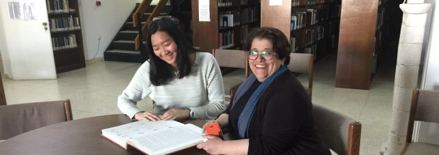 AMIDEAST student Ronnie Zhu (left) at work with NEH Fellow Dr. Aseel Sawalha in the ACOR Library (photo by S. Harpending)