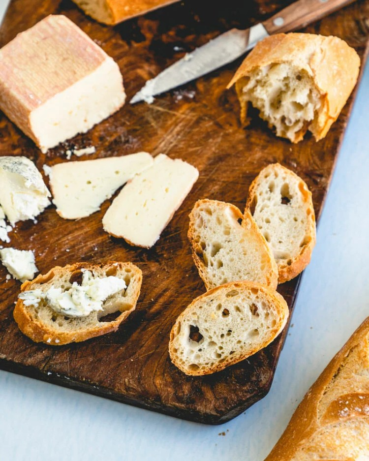 Baguette on cheese board