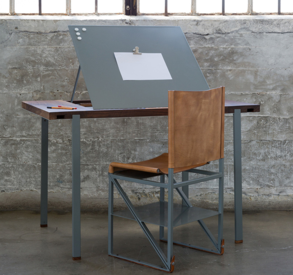 desk chair lowers itself dining steel buy stephen kenn teams up with victorinox on a line of multi
