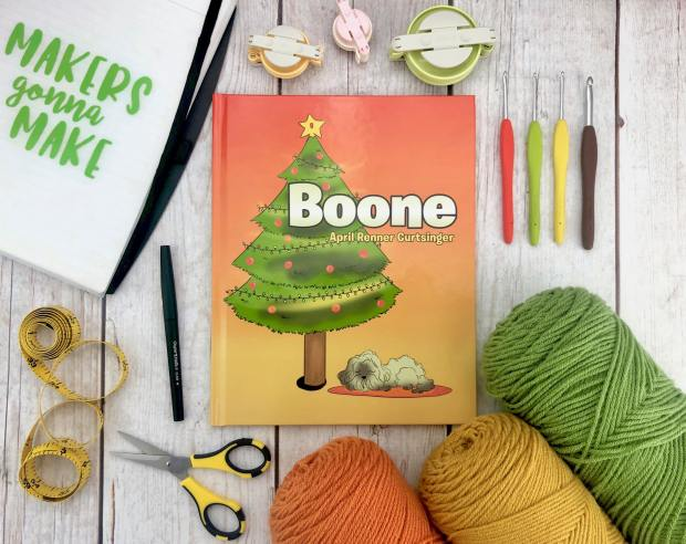 """A crochet designer challenge to design a puppy pattern inspired by the puppy in the children's book """"Boone""""."""