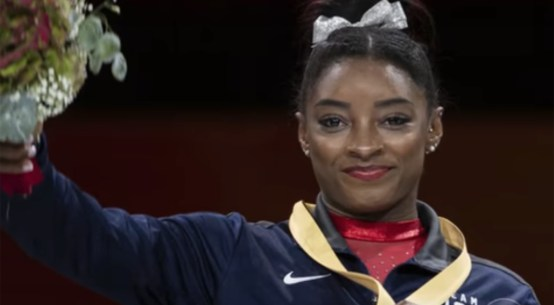 Simone Biles collecting a gold medal at the Artistic World Championships in Stuttgart