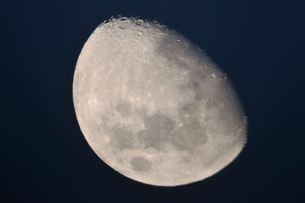 picture of half-moon taken through a telescope