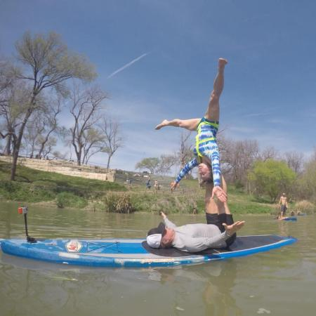 Sue and me playing after our SUP AcroYoga class on the Colorado River at PLAY Acro Festival near Aus
