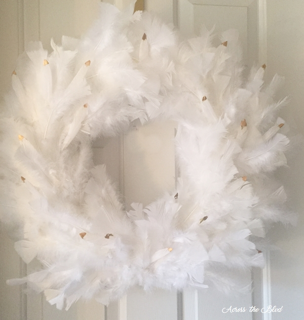 White Feather Wreath with Gold Accents Across the Blvd