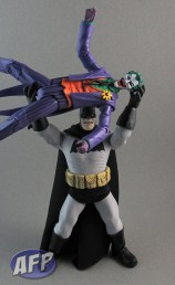 He is holding Joker with no help