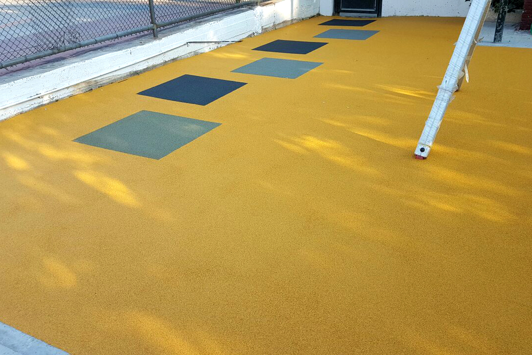 Supply and installation of wet-poured safety floor in a playground of the Municipality of Athens