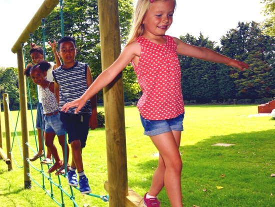 Girl balancing on adventure trim trail