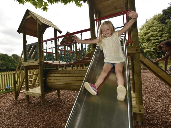 Litcham play tower showing the stainless steel slideslide