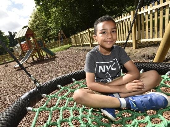 Boy sitting in a nest swing