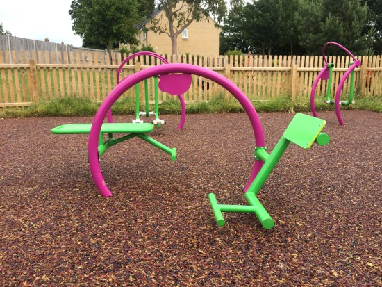 back and stomach trainer side view in a playground - outdoor gym equipment for children or primary schools