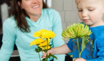Mother and son with flowers