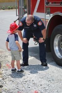 fireman-with-boy-200x300